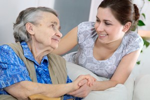 caregiver-and-woman-holding-hands